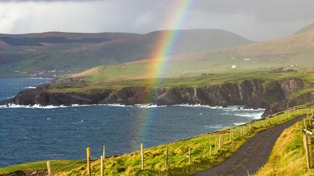 rainbow over coast line